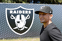 ALAMEDA, CA - AUGUST 26:  UFC bantamweight champion TJ Dillashaw attends the Oakland Raiders practice at the Oakland Raiders training facility on August 26, 2014 in Alameda, California. (Photo by Jeff Bottari/Zuffa LLC/Zuffa LLC via Getty Images)