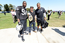 ALAMEDA, CA - AUGUST 26:  (L-R) Oakland Raiders defensive lineman Antonio Smith, UFC bantamweight champion TJ Dillashaw and linebacker LaMarr Woodley interact at the Oakland Raiders training facility on August 26, 2014 in Alameda, California. (Photo by Jeff Bottari/Zuffa LLC/Zuffa LLC via Getty Images)