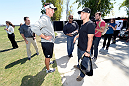 ALAMEDA, CA - AUGUST 26:  (L-R) Oakland Raiders head coach Dennis Allen meets UFC bantamweight champion TJ Dillashaw at the Oakland Raiders training facility on August 26, 2014 in Alameda, California. (Photo by Jeff Bottari/Zuffa LLC/Zuffa LLC via Getty Images)