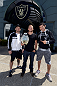 ALAMEDA, CA - AUGUST 26:  (L-R) Dany Marks, UFC bantamweight champion TJ Dillashaw and lightweight Gilbert Melendez visit the Oakland Raiders training facility on August 26, 2014 in Alameda, California. (Photo by Jeff Bottari/Zuffa LLC/Zuffa LLC via Getty Images)