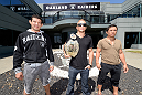 ALAMEDA, CA - AUGUST 26:  (L-R) UFC lightweight Gilbert Melendez, bantamweight champion TJ Dillashaw and flyweight Joseph Benavidez visit the Oakland Raiders training facility on August 26, 2014 in Alameda, California. (Photo by Jeff Bottari/Zuffa LLC/Zuffa LLC via Getty Images)