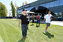 ALAMEDA, CA - AUGUST 26:  (L-R) UFC bantamweight champion TJ Dillashaw and Gilbert Melendez attend the Oakland Raiders practice at the Oakland Raiders training facility on August 26, 2014 in Alameda, California. (Photo by Jeff Bottari/Zuffa LLC/Zuffa LLC via Getty Images)