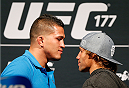 SACRAMENTO, CA - AUGUST 29:  (L-R) UFC lightweight champion Anthony Pettis and Urijah Faber jokingly face off for fans during a Q&A session before the UFC 177 weigh-in at Sleep Train Arena on August 29, 2014 in Sacramento, California.  (Photo by Josh Hedges/Zuffa LLC/Zuffa LLC via Getty Images)
