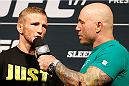 SACRAMENTO, CA - AUGUST 29:  (L-R) UFC bantamweight champion T.J. Dillashaw is interviewed by Joe Rogan during the UFC 177 weigh-in at Sleep Train Arena on August 29, 2014 in Sacramento, California.  (Photo by Josh Hedges/Zuffa LLC/Zuffa LLC via Getty Images)
