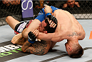 SACRAMENTO, CA - AUGUST 30:  (R-L) Chris Wade secures a guillotine choke submission against Cain Carrizosa in their lightweight bout during the UFC 177 event at Sleep Train Arena on August 30, 2014 in Sacramento, California.  (Photo by Josh Hedges/Zuffa LLC/Zuffa LLC via Getty Images)