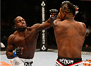SACRAMENTO, CA - AUGUST 30:  (L-R) Derek Brunson punches Lorenz Larkin in their middleweight bout during the UFC 177 event at Sleep Train Arena on August 30, 2014 in Sacramento, California.  (Photo by Josh Hedges/Zuffa LLC/Zuffa LLC via Getty Images)