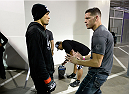SACRAMENTO, CA - AUGUST 30:  (L-R) Yancy Medeiros talks with Nate Diaz before his lightweight fight against Brandon Jackson at UFC 177 inside the Sleep Train Arena on August 30, 2014 in Sacramento, California. (Photo by Jeff Bottari/Zuffa LLC/Zuffa LLC via Getty Images)