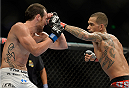 SACRAMENTO, CA - AUGUST 30:  (R-L) Yancy Medeiros punches Brandon Jackson in their lightweight fight at UFC 177 inside the Sleep Train Arena on August 30, 2014 in Sacramento, California. (Photo by Jeff Bottari/Zuffa LLC/Zuffa LLC via Getty Images)