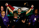 SACRAMENTO, CA - AUGUST 30:  Ramsey Nijem enters the arena before his lightweight bout against Diego Ferreira during the UFC 177 event at Sleep Train Arena on August 30, 2014 in Sacramento, California.  (Photo by Josh Hedges/Zuffa LLC/Zuffa LLC via Getty Images)