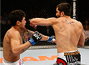 SACRAMENTO, CA - AUGUST 30:  (R-L) Ramsey Nijem punches Diego Ferreira of Brazil in their lightweight bout during the UFC 177 event at Sleep Train Arena on August 30, 2014 in Sacramento, California.  (Photo by Josh Hedges/Zuffa LLC/Zuffa LLC via Getty Images)
