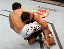 SACRAMENTO, CA - AUGUST 30:  (L-R) Diego Ferreira of Brazil attempts to secure a guillotine choke submission against Ramsey Nijem in their lightweight bout during the UFC 177 event at Sleep Train Arena on August 30, 2014 in Sacramento, California.  (Photo by Josh Hedges/Zuffa LLC/Zuffa LLC via Getty Images)