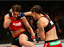 SACRAMENTO, CA - AUGUST 30:  (R-L) Shayna Baszler punches Bethe Correia of Brazil in their women's bantamweight bout during the UFC 177 event at Sleep Train Arena on August 30, 2014 in Sacramento, California.  (Photo by Josh Hedges/Zuffa LLC/Zuffa LLC via Getty Images)