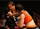 SACRAMENTO, CA - AUGUST 30:  (R-L) Bethe Correia of Brazil punches Shayna Baszler in their women's bantamweight bout during the UFC 177 event at Sleep Train Arena on August 30, 2014 in Sacramento, California.  (Photo by Josh Hedges/Zuffa LLC/Zuffa LLC via Getty Images)