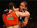 SACRAMENTO, CA - AUGUST 30:  (L-R) Bethe Correia of Brazil punches Shayna Baszler in their women's bantamweight bout during the UFC 177 event at Sleep Train Arena on August 30, 2014 in Sacramento, California.  (Photo by Josh Hedges/Zuffa LLC/Zuffa LLC via Getty Images)