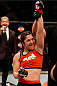 SACRAMENTO, CA - AUGUST 30:  Bethe Correia of Brazil celebrates after her TKO victory over Shayna Baszler in their women's bantamweight bout during the UFC 177 event at Sleep Train Arena on August 30, 2014 in Sacramento, California.  (Photo by Josh Hedges/Zuffa LLC/Zuffa LLC via Getty Images)