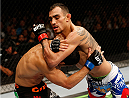 SACRAMENTO, CA - AUGUST 30:  (R-L) Tony Ferguson attempts to secure a darce choke against Danny Castillo in their lightweight bout during the UFC 177 event at Sleep Train Arena on August 30, 2014 in Sacramento, California.  (Photo by Josh Hedges/Zuffa LLC/Zuffa LLC via Getty Images)