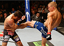 SACRAMENTO, CA - AUGUST 30:  (R-L) T.J. Dillashaw kicks Joe Soto in their UFC bantamweight championship bout during the UFC 177 event at Sleep Train Arena on August 30, 2014 in Sacramento, California.  (Photo by Josh Hedges/Zuffa LLC/Zuffa LLC via Getty Images)