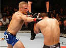SACRAMENTO, CA - AUGUST 30:  (L-R) T.J. Dillashaw punches Joe Soto in their UFC bantamweight championship bout during the UFC 177 event at Sleep Train Arena on August 30, 2014 in Sacramento, California.  (Photo by Josh Hedges/Zuffa LLC/Zuffa LLC via Getty Images)