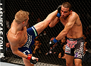 SACRAMENTO, CA - AUGUST 30:  (L-R) T.J. Dillashaw kicks Joe Soto in their UFC bantamweight championship bout during the UFC 177 event at Sleep Train Arena on August 30, 2014 in Sacramento, California.  (Photo by Josh Hedges/Zuffa LLC/Zuffa LLC via Getty Images)