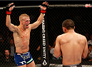 SACRAMENTO, CA - AUGUST 30:  (L-R) T.J. Dillashaw taunts opponent Joe Soto in their UFC bantamweight championship bout during the UFC 177 event at Sleep Train Arena on August 30, 2014 in Sacramento, California.  (Photo by Josh Hedges/Zuffa LLC/Zuffa LLC via Getty Images)