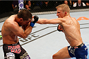 SACRAMENTO, CA - AUGUST 30:  (R-L) T.J. Dillashaw punches Joe Soto in their UFC bantamweight championship bout during the UFC 177 event at Sleep Train Arena on August 30, 2014 in Sacramento, California.  (Photo by Josh Hedges/Zuffa LLC/Zuffa LLC via Getty Images)