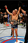 SACRAMENTO, CA - AUGUST 30:  T.J. Dillashaw celebrates after his knockout victory over Joe Soto in their UFC bantamweight championship bout during the UFC 177 event at Sleep Train Arena on August 30, 2014 in Sacramento, California.  (Photo by Josh Hedges/Zuffa LLC/Zuffa LLC via Getty Images)