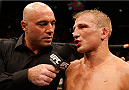 SACRAMENTO, CA - AUGUST 30:  T.J. Dillashaw is interviewed by Joe Rogan after his victory over Joe Soto in their UFC bantamweight championship bout during the UFC 177 event at Sleep Train Arena on August 30, 2014 in Sacramento, California.  (Photo by Josh Hedges/Zuffa LLC/Zuffa LLC via Getty Images)