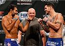 MASHANTUCKET, CT - SEPTEMBER 04:  (L-R) Opponents Rafael Natal of Brazil and Chris Camozzi face off during the UFC Fight Night weigh-in at Foxwoods Resort Casino on September 4, 2014 in Mashantucket, Connecticut.  (Photo by Josh Hedges/Zuffa LLC/Zuffa LLC via Getty Images)