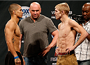 MASHANTUCKET, CT - SEPTEMBER 04:  (L-R) Opponents John Moraga and Justin Scoggins face off during the UFC Fight Night weigh-in at Foxwoods Resort Casino on September 4, 2014 in Mashantucket, Connecticut.  (Photo by Josh Hedges/Zuffa LLC/Zuffa LLC via Getty Images)