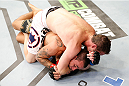 MASHANTUCKET, CT - SEPTEMBER 05: Chas Skelly (top) attempts to secure a rear choke submision against Sean Soriano in their featherweight bout during the UFC Fight Night event at Foxwoods Resort Casino on September 5, 2014 in Mashantucket, Connecticut. (Photo by Josh Hedges/Zuffa LLC/Zuffa LLC via Getty Images)