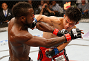 MASHANTUCKET, CT - SEPTEMBER 05:  (R-L) Tateki Matsuda punches Chris Beal in their bantamweight bout during the UFC Fight Night event at Foxwoods Resort Casino on September 5, 2014 in Mashantucket, Connecticut.  (Photo by Josh Hedges/Zuffa LLC/Zuffa LLC via Getty Images)