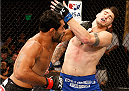 MASHANTUCKET, CT - SEPTEMBER 05:  (L-R) Rafael Natal of Brazil punches Chris Camozzi in their middleweight bout during the UFC Fight Night event at Foxwoods Resort Casino on September 5, 2014 in Mashantucket, Connecticut.  (Photo by Josh Hedges/Zuffa LLC/Zuffa LLC via Getty Images)
