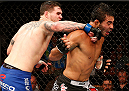 MASHANTUCKET, CT - SEPTEMBER 05:  (L-R) Chris Camozzi punches Rafael Natal of Brazil in their middleweight bout during the UFC Fight Night event at Foxwoods Resort Casino on September 5, 2014 in Mashantucket, Connecticut.  (Photo by Josh Hedges/Zuffa LLC/Zuffa LLC via Getty Images)