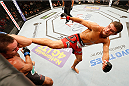 MASHANTUCKET, CT - SEPTEMBER 05:  (R-L) Al Iaquinta kicks Rodrigo Damm of Brazil in their lightweight bout during the UFC Fight Night event at Foxwoods Resort Casino on September 5, 2014 in Mashantucket, Connecticut.  (Photo by Josh Hedges/Zuffa LLC/Zuffa LLC via Getty Images)