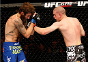 MASHANTUCKET, CT - SEPTEMBER 05:  (R-L) Joe Lauzon punches Michael Chiesa in their lightweight bout during the UFC Fight Night event at Foxwoods Resort Casino on September 5, 2014 in Mashantucket, Connecticut.  (Photo by Josh Hedges/Zuffa LLC/Zuffa LLC via Getty Images)