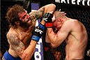 MASHANTUCKET, CT - SEPTEMBER 05:  (L-R) Michael Chiesa throws an elbow to the head of Joe Lauzon in their lightweight bout during the UFC Fight Night event at Foxwoods Resort Casino on September 5, 2014 in Mashantucket, Connecticut.  (Photo by Josh Hedges/Zuffa LLC/Zuffa LLC via Getty Images)