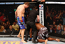MASHANTUCKET, CT - SEPTEMBER 05:  (L-R) Matt Mitrione knocks out Derrick Lewis as referee Mario Yamasaki calls the fight in their heavyweight bout during the UFC Fight Night event at Foxwoods Resort Casino on September 5, 2014 in Mashantucket, Connecticut.  (Photo by Josh Hedges/Zuffa LLC/Zuffa LLC via Getty Images)