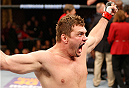 MASHANTUCKET, CT - SEPTEMBER 05:  Matt Mitrione celebrates after knocking out Derrick Lewis in their heavyweight bout during the UFC Fight Night event at Foxwoods Resort Casino on September 5, 2014 in Mashantucket, Connecticut.  (Photo by Josh Hedges/Zuffa LLC/Zuffa LLC via Getty Images)