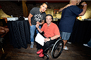 MASHANTUCKET, CT - SEPTEMBER 5: UFC lightweight champion Anthony Pettis poses with a fan at the UFC's The Ultimate Fighter 20 event inside the Shrine at Foxwoods Resort Casino on September 5, 2014 in Mashantucket, Connecticut. (Photo by Jeff Bottari/Zuffa LLC/Zuffa LLC via Getty Images)
