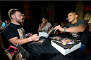 MASHANTUCKET, CT - SEPTEMBER 5: UFC lightweight champion Anthony Pettis signs autographs for fans at the UFC's The Ultimate Fighter 20 event inside the Shrine at Foxwoods Resort Casino on September 5, 2014 in Mashantucket, Connecticut. (Photo by Jeff Bottari/Zuffa LLC/Zuffa LLC via Getty Images)