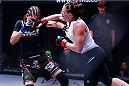 Tara LaRosa lands a right hook against Roxanne Modafferi at Invicta Fighting Championships 8. (Photos by Esther Lin/INVICTA FC.)