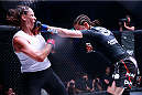 Roxanne Modafferi punches Tara LaRosa during their 125lb bout during Invicta FC 8. (Photos by Esther Lin/INVICTA FC.)