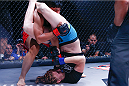 Tonya Evinger works the submission finish in her Invicta FC 8 bout. (Photos by Esther Lin/INVICTA FC.)