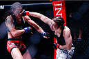 Katja Kankaanpaa punches Stephanie Eggink during their strawweight title fight during Invicta FC 8. (Photos by Esther Lin/INVICTA FC.)