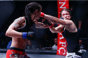Stephanie Eggink punches Katja Kankaanpaa during their strawweight title fight at Invicta FC 8. (Photos by Esther Lin/INVICTA FC.)