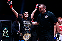 Michelle Waterson celebrates after defending her Atomweight title at Invicta FC 8. (Photos by Esther Lin/INVICTA FC.)