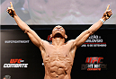 BRASILIA, BRAZIL - SEPTEMBER 12:  Francisco Trinaldo of Brazil poses on the scale after weighing in during the UFC Fight Night weigh-in at the Nilson Nelson Gymnasium on September 12, 2014 in Brasilia, Brazil. (Photo by Josh Hedges/Zuffa LLC/Zuffa LLC via Getty Images)