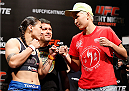 BRASILIA, BRAZIL - SEPTEMBER 12:  (L-R) Opponents Jessica Andrade of Brazil and Larissa Pacheco of Brazil face off during the UFC Fight Night weigh-in at the Nilson Nelson Gymnasium on September 12, 2014 in Brasilia, Brazil. (Photo by Josh Hedges/Zuffa LLC/Zuffa LLC via Getty Images)