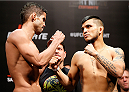 BRASILIA, BRAZIL - SEPTEMBER 12:  (L-R) Opponents Leonardo Santos of Brazil and Efrain Escudero of Mexico face off during the UFC Fight Night weigh-in at the Nilson Nelson Gymnasium on September 12, 2014 in Brasilia, Brazil. (Photo by Josh Hedges/Zuffa LLC/Zuffa LLC via Getty Images)