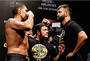 "BRASILIA, BRAZIL - SEPTEMBER 12:  (L-R) Opponents Antonio ""Bigfoot"" Silva of Brazil and Andrei Arlovski of Belarus face off during the UFC Fight Night weigh-in at the Nilson Nelson Gymnasium on September 12, 2014 in Brasilia, Brazil. (Photo by Josh Hedges/Zuffa LLC/Zuffa LLC via Getty Images)"